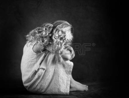 13115876-sad-little-girl-in-black-and-white
