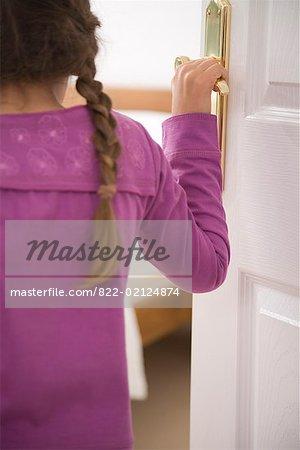 822-02124874em-close-up-of-young-girl-opening-bedroom-door-stock-photo.jpg