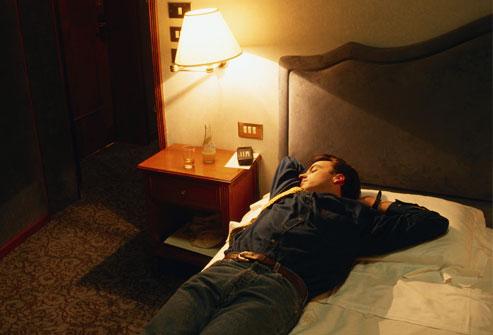 getty_rf_photo_of_man_sleeping_in_clothes.jpg