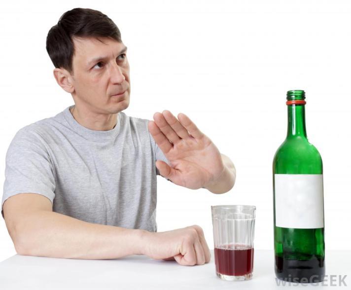 man-refusing-bottle-of-wine.jpg